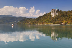 The castle of Bled reflected in Lake Bled, Slovenia Stock Photos
