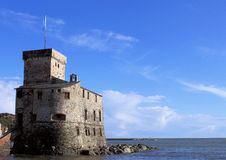 Castle in blue. A medieval castle in italian riviera Stock Photography