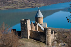 Castle on blue lake Stock Images