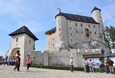 Castle of Bobolice, Poland. People admiring the Castle of Bobolice, renovated in 2011 by its owner Stock Image