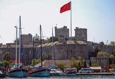 Castle in Bodrum. Bodrum, Turkey - August 29, 2007: Bodrum fortress historical fortification located in the port city of Bodrum, view from marina royalty free stock photography