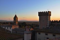 Castle of Bolgheri and Elba island in sunset royalty free stock photo