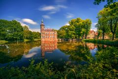 Castle Bouvigne and the surrounding park in Breda, Netherlands. Castle Bouvigne and the surrounding park with reflection in water situated near the Dutch city of royalty free stock photo
