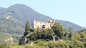 Castle Brunnenburg and mountain panorama in Tirol, South Tyrol. Italy Royalty Free Stock Images