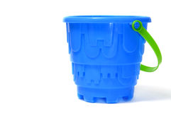 Castle bucket. A blue castle bucket isolated on a white background Royalty Free Stock Photography