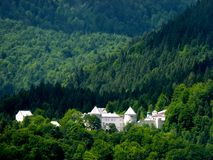 Large castle in the middle of a wooded area in southern Germany. Castle building in the forest, mountain forest, with castle complex, wooded area with historical royalty free stock image