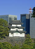 Castle and buildings. A photograph illustrating the merging of traditional and modern structures in Japan Stock Image