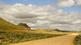 Castle Butte saskatchewan. A large mineral rock in a valley with a gravel road winding through the valley Royalty Free Stock Images