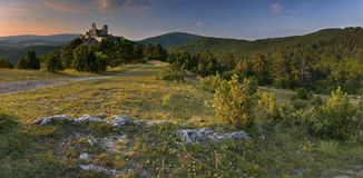 The castle of Cachtice. A view of ruined Castle of Cachtice situated in the mountains above the Cachtice village in the west of Slovakia in Trencin region. The stock photo