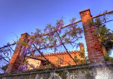 The castle of Candia among the wisterias royalty free stock image