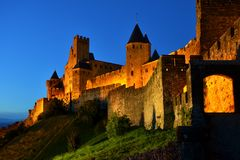 Castle at Carcassonne, France, illuminated at night. Ancient walled city of Carcassonne, France, lit in the early night Royalty Free Stock Images