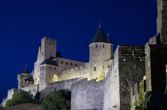 Castle of Carcassonne illuminated. Castle of Cracassonne's Citadel from the Door of Aude illuminated at sunset stock image