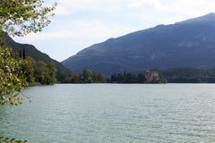 Castle Castel Toblino at lake Lago di Toblino and mountain panorama, Italy Stock Photo