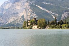 Castle Castel Toblino at lake Lago di Toblino and mountain panorama, Italy Stock Image