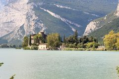 Castle Castel Toblino at lake Lago di Toblino and mountain panorama, Italy stock photography