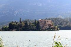 Castle Castel Toblino at lake Lago di Toblino and mountain panorama, Italy Royalty Free Stock Photography