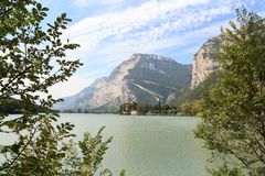Castle Castel Toblino at lake Lago di Toblino and mountain panorama, Italy Stock Photos