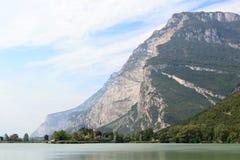 Castle Castel Toblino at lake Lago di Toblino and mountain panorama, Italy Royalty Free Stock Photo