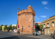 Castle, Castillet or porte Notre-Dame or Petit-Castillet, detail tower with Catalan flag, historical monument in Perpignan, royalty free stock photo