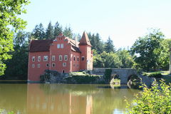 Castle Cervena Lhota. Red water castle Cervena Lhota with stone bridge in middle of lake (Czech Republic royalty free stock photos