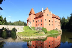 Castle Cervena Lhota. Red water castle Cervena Lhota with stone bridge in middle of lake (Czech Republic stock photos