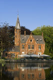 Castle on a channel in Brugge. View of castle on a channel in Brugge / Bruges, Belgium Stock Photos