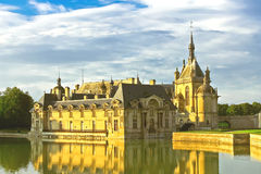 Castle of Chantilly at sunset. Stock Image