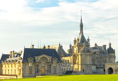 Castle of Chantilly at sunset. Royalty Free Stock Image