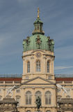 Castle Charlottenburg. Frontview of castle charlottenburg, with fence, dome and statue fortuna. The building was inaugurated at the 11.June.1699. Before the royalty free stock photo