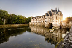 Castle Chateau de Chenonceau at sunset, France. The Chateau de Chenonceau at sunset, France. This castle is located near the small village of Chenonceaux in the stock photography