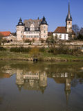Castle and church. Old castle with two towers and a church at a lake royalty free stock photos