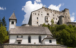 Castle and church in Austrian Alps Royalty Free Stock Photo