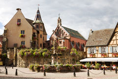 Castle, church and fountain named Saint Leon in Eguisheim village Stock Image