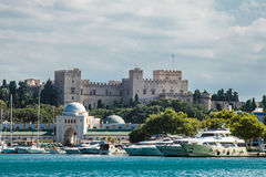 Castle and city walls of Rhodes view with harbor. Royalty Free Stock Images
