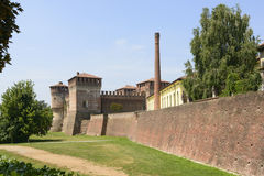 Castle and City walls, Soncino. View from west of the Sforzesco Castle and the ancient city walls with an old industrial chimney, shot in bright summer light stock images