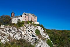 Castle on the cliff. Chateau on the rocky cliff stock photo