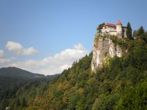Castle on a Cliff. Bled Castle hanging over a cliff in Slovenia royalty free stock photo