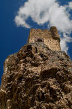 Castle on cliff. A view looking upwards at a vertical cliff in Spain to an old castle or fortress built at the top Stock Photos