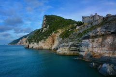Castle on cliffs over the sea Royalty Free Stock Images