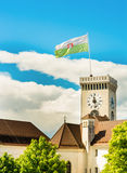 Castle clock tower with a flag Royalty Free Stock Image