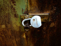 Castle. Closed lock,hardened on a rusty gate Stock Photography