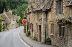 Castle Combe, Cotswolds cottages. The quaint fairy tale village of Castle Combe at the border between the Cotswolds and Wiltshire with its characteristic old Royalty Free Stock Photography