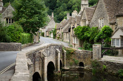 Castle Combe, Cotswolds village. The quaint fairy tale village of Castle Combe at the border between the Cotswolds and Wiltshire with its characteristic bridge Stock Photography