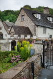 Castle Combe, unique old English village. Old house and park Royalty Free Stock Photos