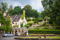 Castle Combe, unique old English village. Old house and park Stock Photo