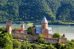 Castle complex with church on Aragvi river, Ananuri, Georgia.  Royalty Free Stock Image