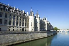 Castle Conciergerie  and bridge over Seine, Paris Royalty Free Stock Image
