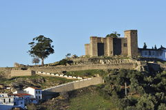 The Castle, Cortegana. Andalusian village Tranquil Andalusian white village with mountains, trees and castle, in the background Stock Images
