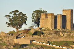 The Castle, Cortegana. Andalusian village Tranquil Andalusian white village with mountains, trees and castle, in the background Royalty Free Stock Images