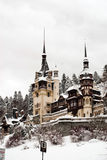 Castle covered in snow. A medieval castle surrounded by a  garden covered in snow Stock Photography
